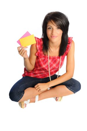 attractive hispanic woman on a white background holding school or office supplies Stock Photo - 7569130