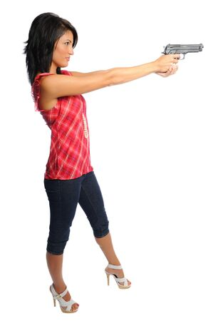 attracive hispanic woman holding a pistol ready to shoot on a white background