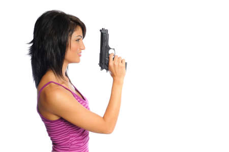 attractive hispanic woman profile holding a pistol on a white background