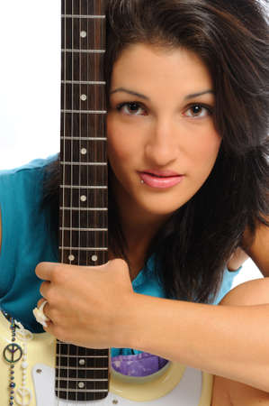 attractive young hispanic woman portrait with a guitar on a white background