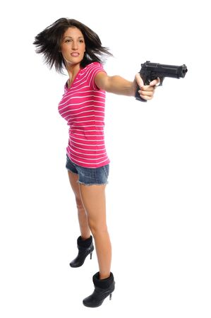 hispanic woman with a gun showing hair fly on a white background