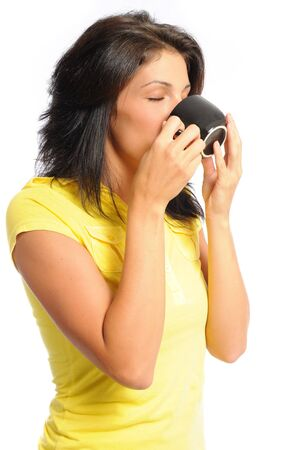 attractive young hispanic woman drinking a cup of coffee on a white background