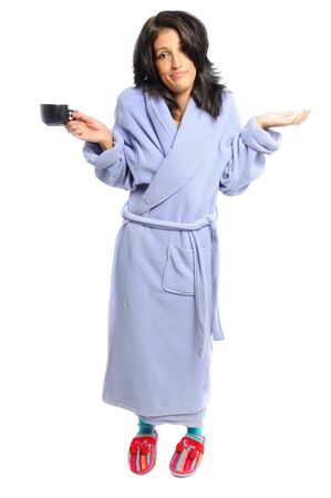 pjs: attractive young hispanic woman in PJs with her morning coffee on a white background