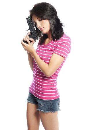 Attractive hispanic woman holding a hand gun on a white background