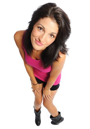 Attractive young hispanic woman in shorts and t-shirt on a white background photo