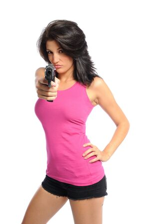 Attractive young hispanic woman with a gun on a white background Banco de Imagens