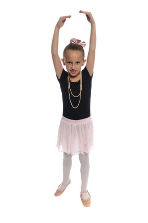 cute young girl posing in a dance costume on a white background
