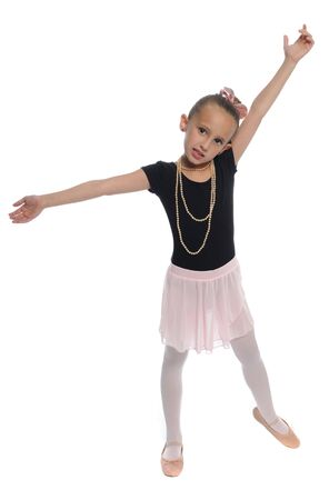 cute young girl posing in a dance costume on a white background Stock Photo - 8140536