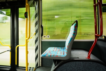 empty seat in a trolley bus  blurred background shows dynamic
