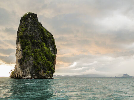 solitaire limestone rock. located in phang nga bay in the Andaman Sea. Thailand photo