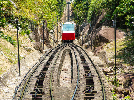 red cograilway is climing up the hill of Penang, Malaysia