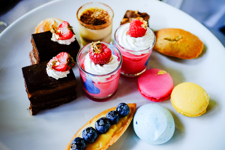 various delicious desserts presented on a white plate photo