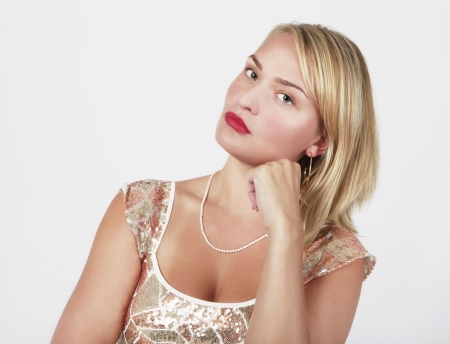 Young blond woman looking upset photo