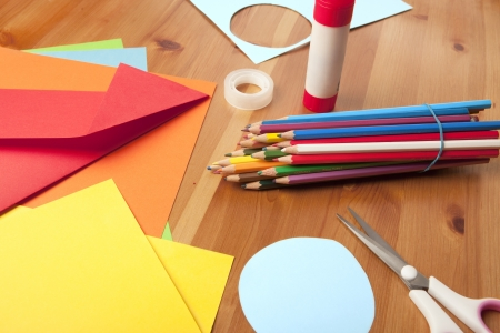 wooden table decoration itself to tinker around with scissors, pencils and drawing paper