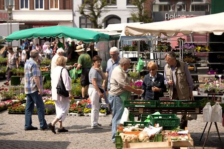 market place: Market place in the Seaport City Husum in the North of Germany with people
