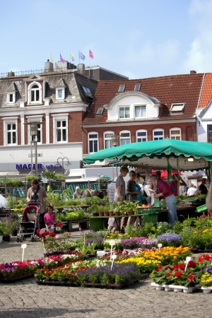 Market place in the Seaport City Husum in the North of Germany with people