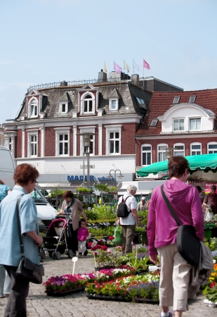 german ocean: Market place in the Seaport City Husum in the North of Germany with people
