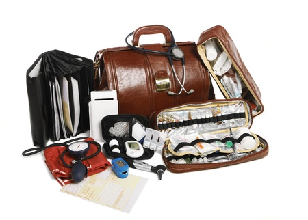 sphygmonanometer: A full packed doc bag with paper work, insurence papers and everything for medical check up on a white background