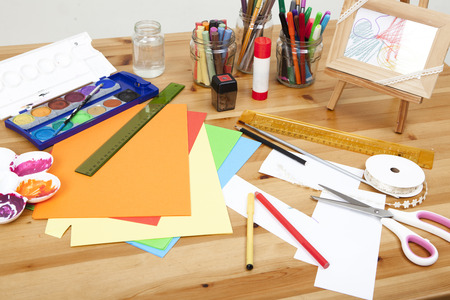 different things lying on a table to try arts and crafts, background white Standard-Bild