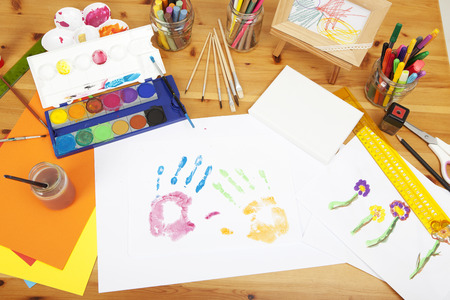 different things lying on a table to try arts and crafts, painted by kids Standard-Bild