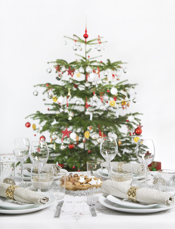 Festive table with christmas tree in the background photo