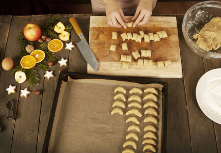 vanilla biscuits are portioned and brought into shape, then laid out on a baking sheet photo