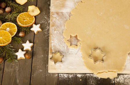 gouged: christmas cookies in the shape of stars are gouged, beside decoration