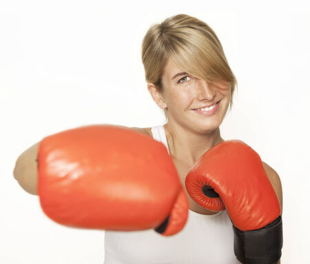 a young sporty woman with red boxing gloves, white background photo