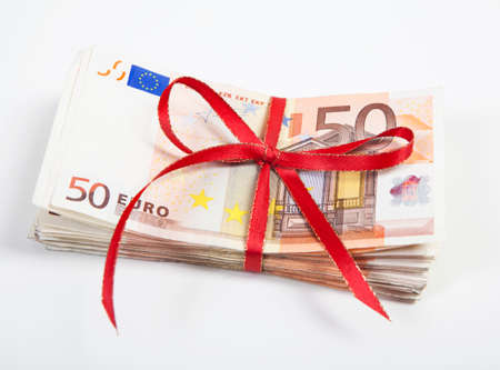 a bundle of euro bills wrapped with a red ribbon. white background photo