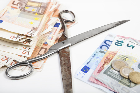 degrading: the scissors between poverty and wealth goes further apart, illustrated with euros Stock Photo