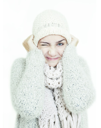 girl with white wool hat and scarf in winter. optional background