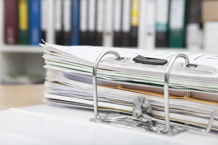 Desk in an office with a full file folder