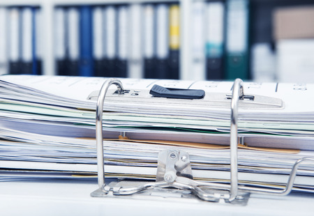 messily: Desk in an office with a full file folder