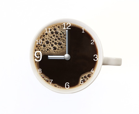 a white coffee cup with nine time clock. isolated background photo