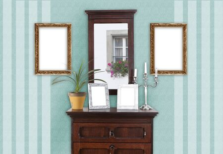 dresser: on a wall with a dresser, several paintings frame