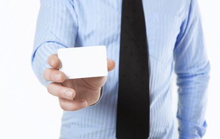 no face: Man in shirt and tie holds a white business card in hand, no face Stock Photo