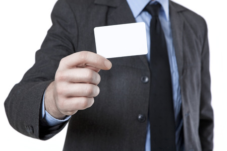 no face: Man in suit with tie holds a white business card in hand, no face Stock Photo