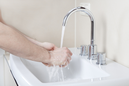 washstand: Wash hands with soap and water on a modern washstand