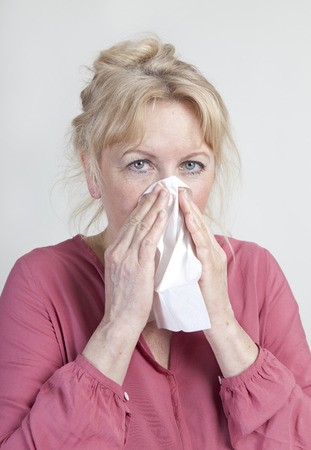 handkerchief: elderly woman with a handkerchief blows his nose