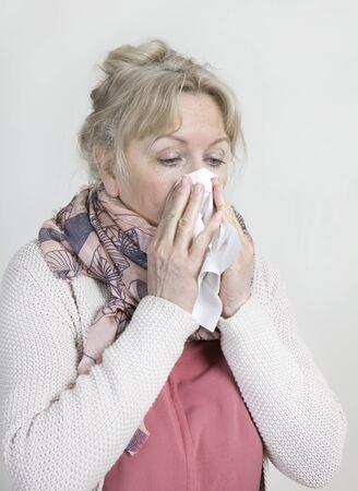 handkerchief: elderly woman with a handkerchief brushing her nose Stock Photo