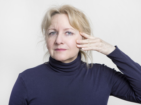 lifted: an older woman with a face half is lifted Stock Photo