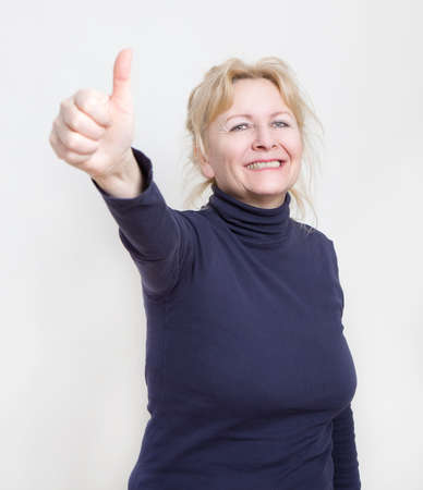 would: an older woman would be showing thumbs up