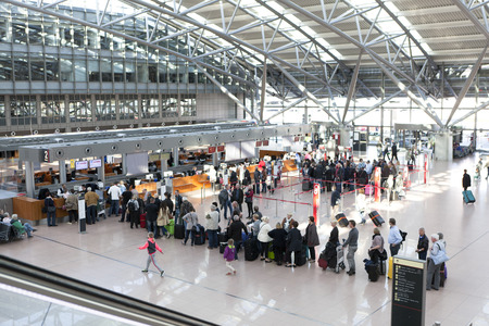 terminals: Tourists with suitcases at Hamburg airport check in area