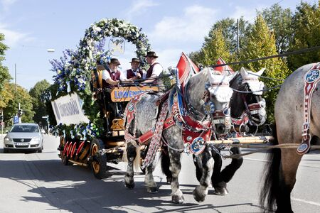 wiesn: Oktoberfest Munich Germany 25.09.2013 large horses pulling a carriage with draft Weissbier Editorial