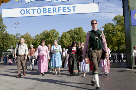 lederhose: Oktoberfest, Munich, Germany, 25092013, entrance to the Oktoberfest with traditionally dressed visitors Editorial