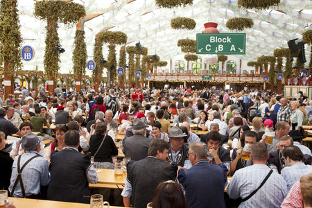 Oktoberfest, Munich, Germany, 25092013, the marquee at the Oktoberfest with traditionally dressed visitors and tourists