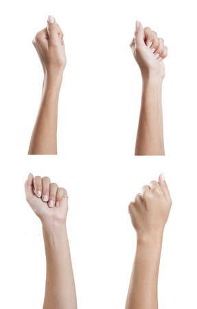 various female hands with beautiful manicured fingernails stretched as fist, background white, isolated