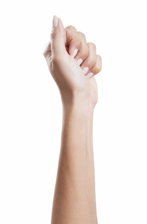 Woman's hand clenched into a fist with beautiful manicured fingernails, background white, isolated Standard-Bild