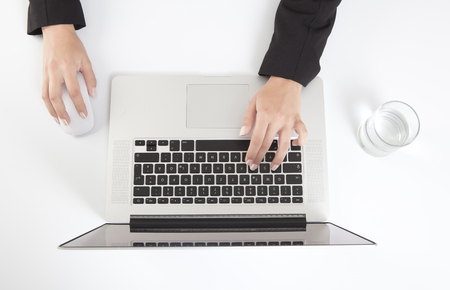 Woman hands in an office working on a computer