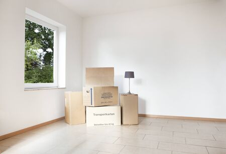 packing boxes: many packing boxes standing in an empty white room